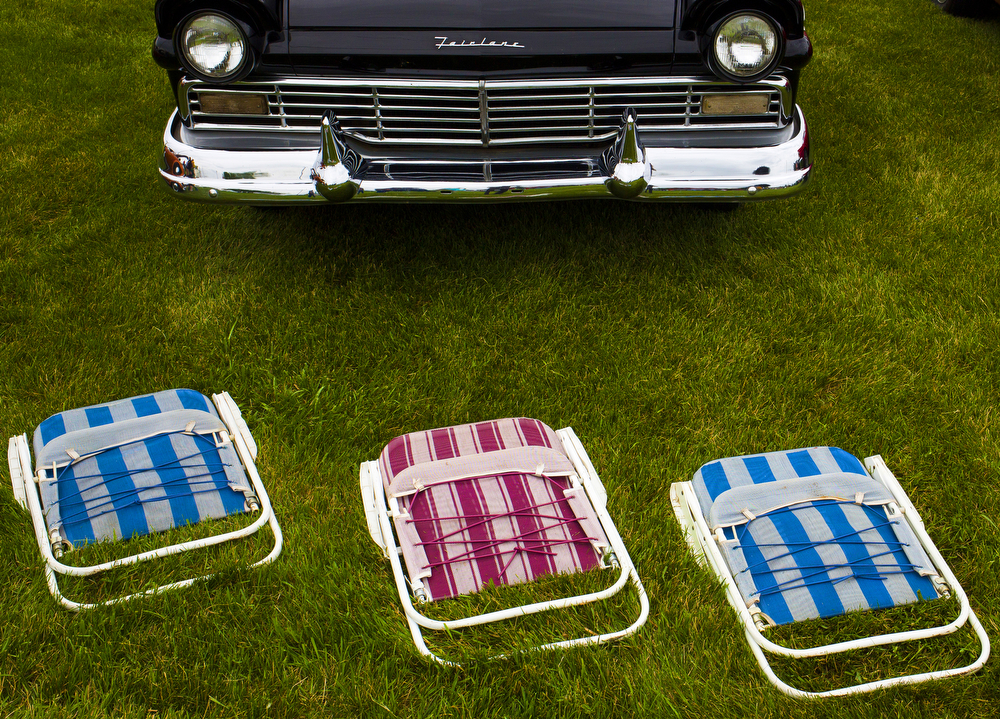 Chairs lie on the grass in front of  a class car at a cruise night Wednesday, June 17, 2015, at Big Boy in Brooklyn, Mich. More than 50 classic and modern cars were on display. (Nick Gonzales | Mlive.com)