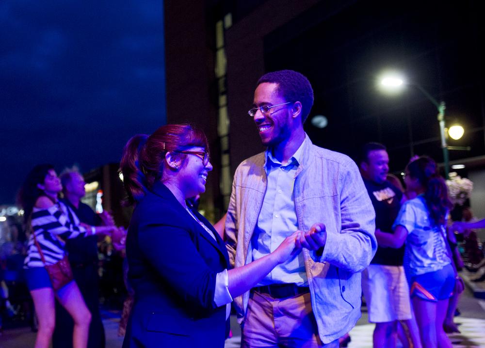 Sharon Hernandez dances with her boyfriend Malik Cato at the Elkhart Jazz Festival on Friday, June 19, 2015, in Elkhart, Indiana.