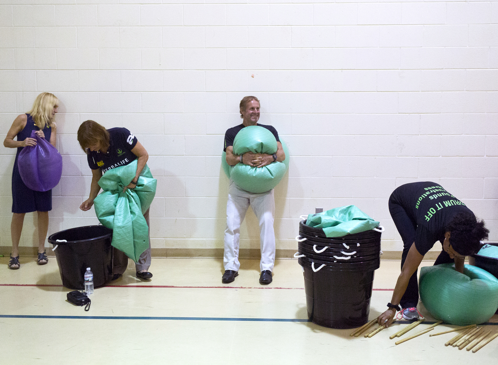 Herbalife members clean up after a workout routine at a presentation Wednesday, June 24, 2015, at Lily Missions Center in Jackson, Michigan. The Herbalife Family Foundation donated $37,000 to the Lily Missions Center. (Nick Gonzales | Mlive.com)