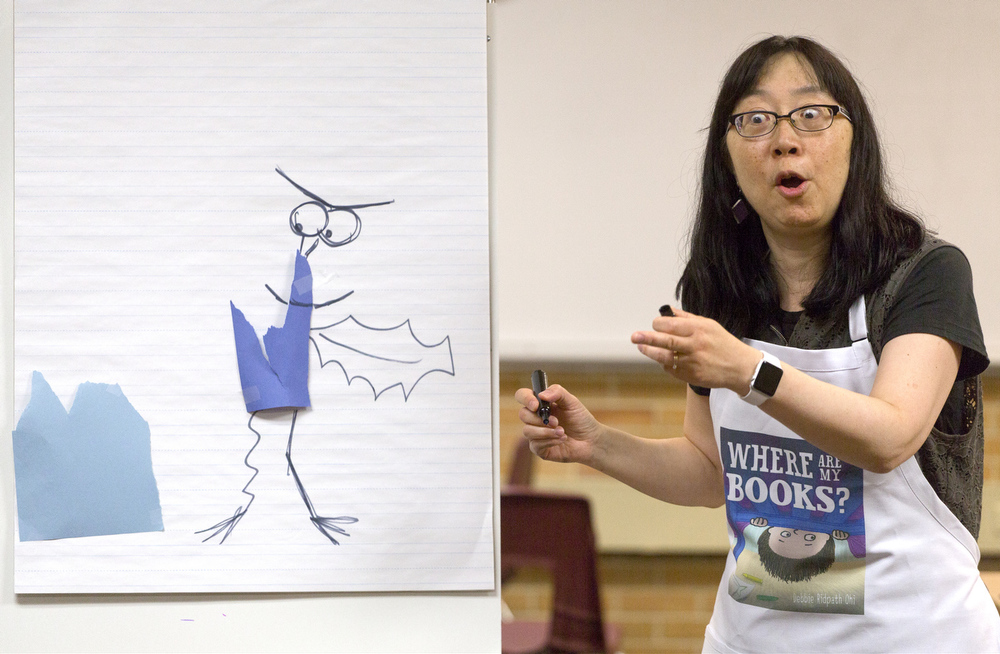 Children's author Debbie Ridpath Ohi creates characters with youngsters at nErDcamp Junior on Tuesday, July 7, 2015, at Western High School in Parma, Michigan. nErDcamp Junior is part of a two a two-day professional development workshop for teachers. Hundreds of children learned the art of storytelling from 24 authors, who take part in the workshop. (Nick Gonzales | Mlive.com)