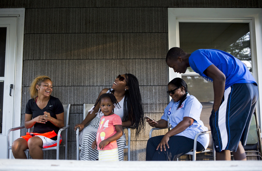 Koryanna Beavers (from left), Brittany Campbell, her daughter Ashlynn Campbell, 2, Khalilah Wright, and Nate Campbell pose for a family picture on the porch Wednesday, July 29, 2015, in Jackson, Mich. (Nick Gonzales | Mlive.com)