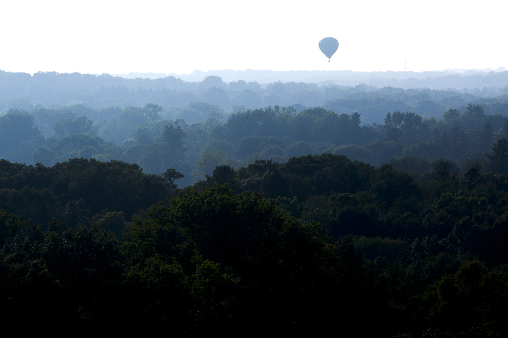A hot air balloon is seen in the distance during a media flight previewing the 33rd annual Hot Air Jubilee on Thursday, July 9, 2015, in Jackson, Michigan. The jubilee will take place July 17-19 at Ella Sharp Park. (Nick Gonzales | Mlive.com)