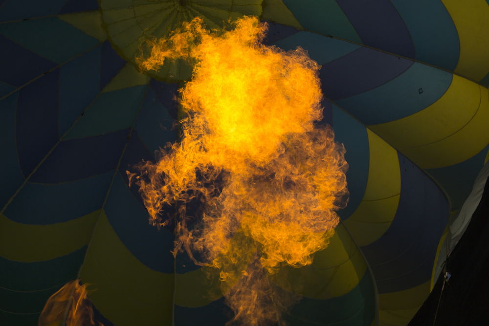 Fire roars into a hot air balloon during a media flight previewing the 33rd annual Hot Air Jubilee on Thursday, July 9, 2015, in Jackson, Michigan. The jubilee will take place July 17-19 at Ella Sharp Park. (Nick Gonzales | Mlive.com)