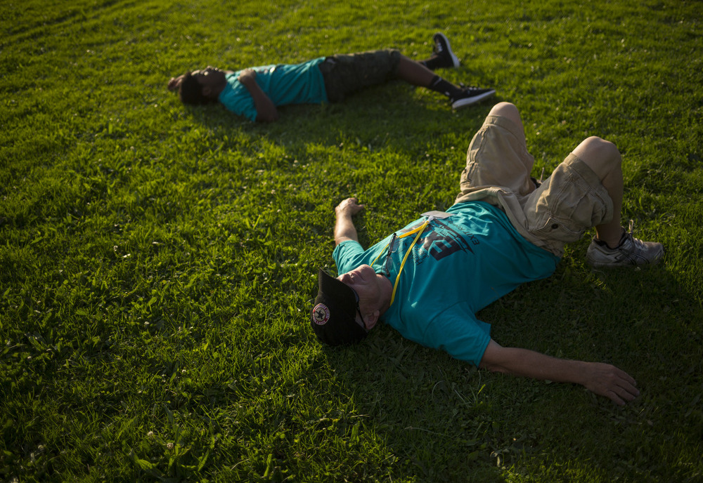 Volunteers rest before helping to unpack a hot air balloon at the Hot Air Jubilee on Friday, July 17, 2015, at Ella Sharp Park in Jackson, Michigan. The jubilee continues on Saturday and Sunday morning with a final early morning hot air balloon launch. (Nick Gonzales | Mlive.com)