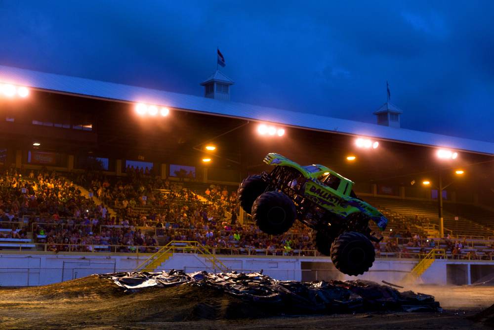 Monster truck Ballistic gets airborne at a monster truck show Friday, Aug. 14, 2015, at the Jackson County Fair in Jackson, Mich. The fair continues Saturday. (Nick Gonzales | Mlive.com)