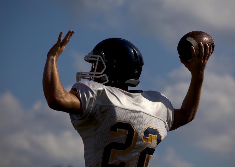 Grass Lake quarterback Kyle Farley makes a pass during football practice Wednesday, Aug. 19, 2015, at Grass Lake High School. (Nick Gonzales | Mlive.com)