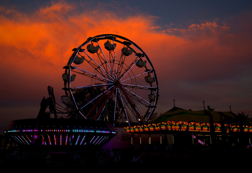 The sun sets over the Jackson County Fair on Monday, Aug. 10, 2015, at the Jackson County Fairgrounds in Jackson, Mich. The fair continues through Saturday, Aug. 15.  (Nick Gonzales | Mlive.com)