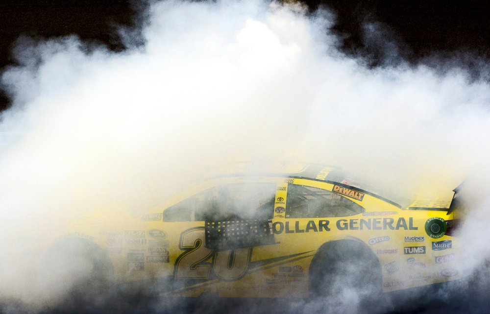 Sprint Cup Series driver Matt Kenseth (20) does a burnout after winning the NASCAR Pure Michigan 400 on Sunday, Aug. 16, 2015 at Michigan International Speedway in Brooklyn, Mich. (Nick Gonzales | Mlive.com)