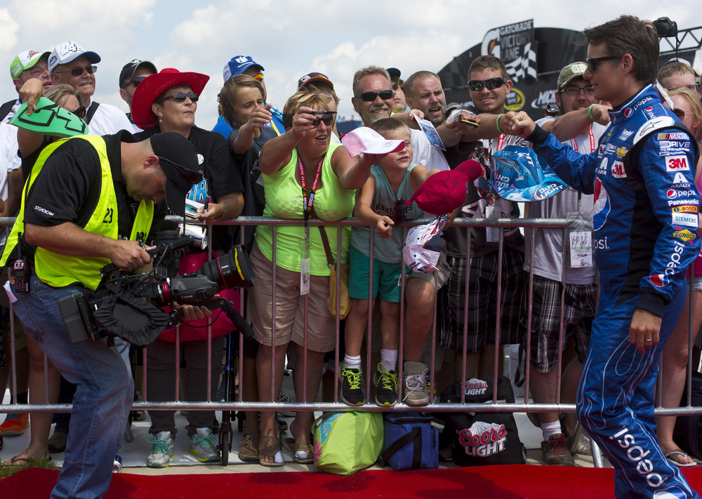 Sprint Cup Series driver Jeff Gordon (24), right, makes his way down the red carpet before competing in his last NASCAR Pure Michigan 400 on Sunday, Aug. 16, 2015 at Michigan International Speedway in Brooklyn, Mich. Gordon announced his retired at the end of the season. (Nick Gonzales | Mlive.com)
