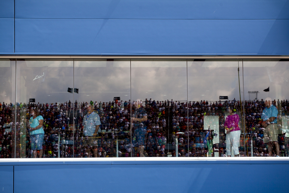 Fans watch prerace ceremonies from the infield suites before the NASCAR Pure Michigan 400 on Sunday, Aug. 16, 2015 at Michigan International Speedway in Brooklyn, Mich. (Nick Gonzales | Mlive.com)