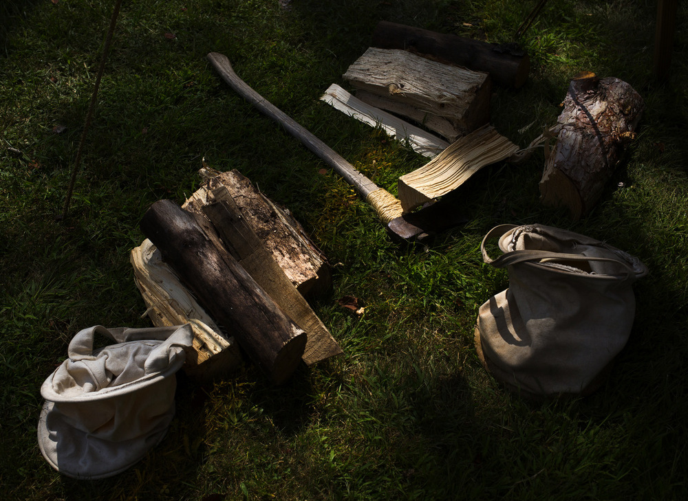 Campers necessities, wood and an axe lay on the ground in the military campsite during the Civil War Muster on Saturday, Aug. 22, 2015, at Cascade Falls Park in Jackson, Mich. Michigan largest civil war re-enactment festival hosted more than 600 reenactors during the two-day event. (Nick Gonzales | Mlive.com)