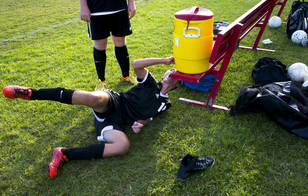 Jonesville's Fred Yaniga (18) takes a drink at halftime during a boys soccer game between Hanover-Horton and Jonesville on Thursday, Sept. 24, 2015, at Hanover-Horton High School. Jonesville won 4-1. (Nick Gonzales | Mlive.com)