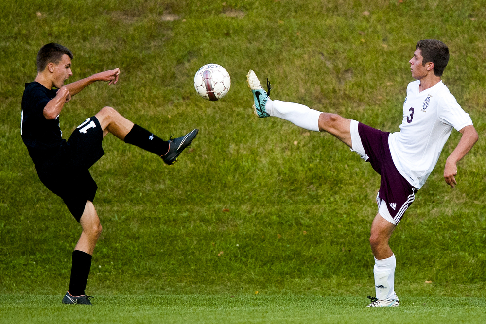 Parma Western's Jake Jones (3)and Marshall's Cody Clapper kick at a ball during a boys soccer game between Parma Western and Marshall on Thursday, Sept. 17, 2015, at Parma Western High School. Marshall won 1-0. (Nick Gonzales | Mlive.com)