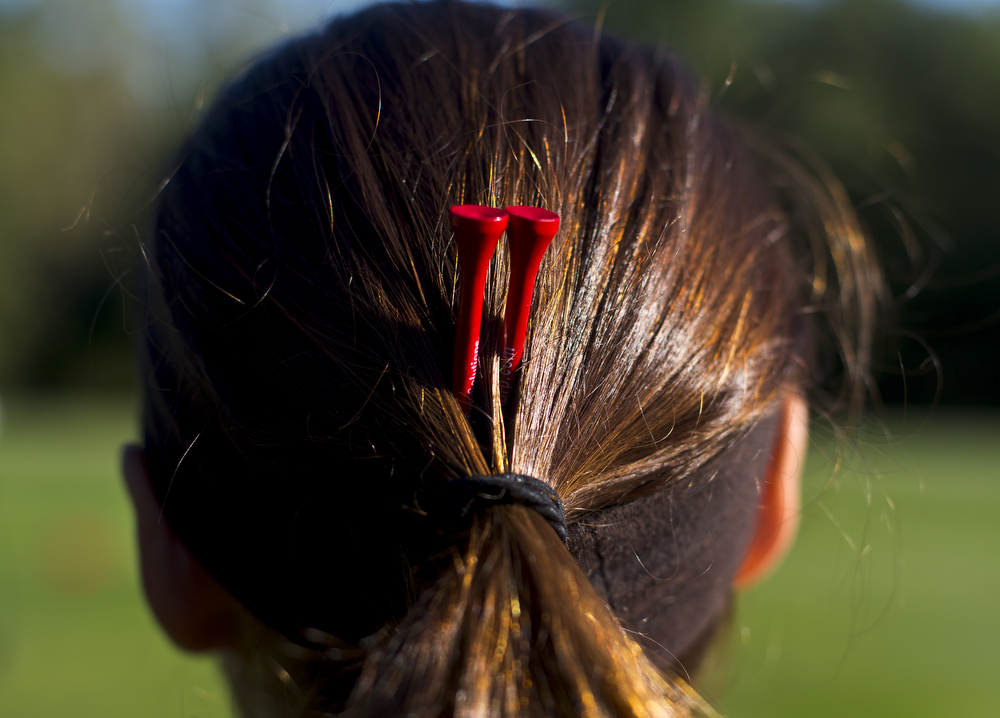 Jackson Northwest senior Kara Stevens keeps tees in her hair during girls golf Interstate-8 Jamboree on Wednesday, Sept. 23, 2015, at Cascades Golf Course in Jackson, Mich. Lumen Christi, Jackson Northwest and Parma Western were three of the seven teams competing. (Nick Gonzales | Mlive.com)