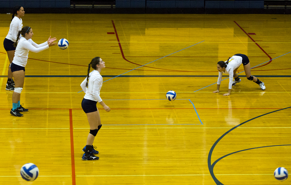 Hillsdale warmup before a volleyball game between Hillsdale and Columbia Central on Tuesday, Sept. 15, 2015, at Hillsdale High School. Columbia Central won 25-20, 25-17, 25-18. (Nick Gonzales | Mlive.com)