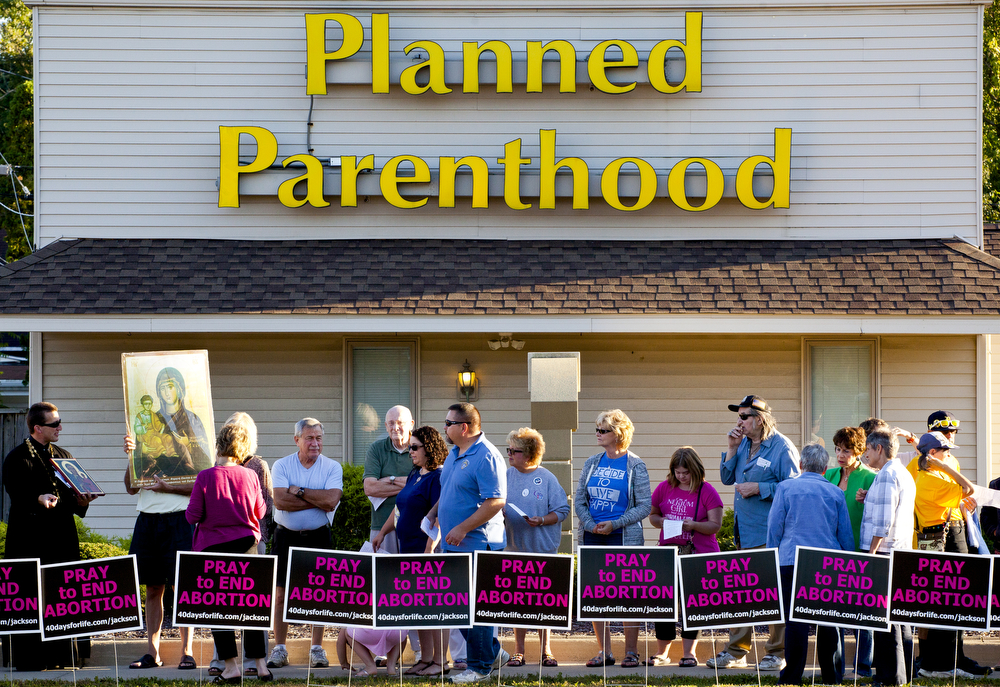 People flood the sidewalk outside of Planned Parenthood during the 40 Days for Life kickoff rally Wednesday, Sept. 23, 2015, on West Michigan Avenue in Jackson, Michigan. More than 100 people attended half-hour event, where participants sang and prayed to end abortion and close Planned Parenthood. (Nick Gonzales | Mlive.com)