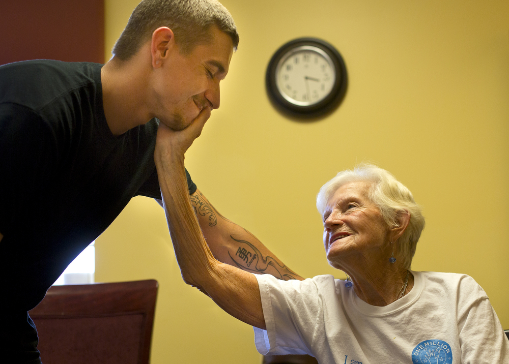 Betty Hendrick, 85, holds her grandson David Hendrick, 20, Tuesday, Sept. 8, 2015, at RidgeCrest Health Campus in Summit Township, Mich. Betty was diagnosed with Alzheimer's five years ago and David is Betty's primary caregiver. She is temporarily at RidgeCrest recovering from a broken knee. (Nick Gonzales | Mlive.com)