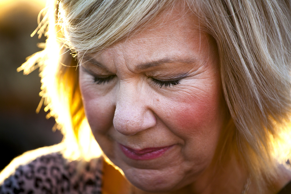 Pastor Tommie Norman of The Father's House closes her eyes during prayer during the 40 Days for Life kickoff rally Wednesday, Sept. 23, 2015, outside of Planned Parenthood on West Michigan Avenue in Jackson, Michigan. More than 100 people attended half-hour event, where participants sang and prayed to end abortion and close Planned Parenthood. (Nick Gonzales | Mlive.com)