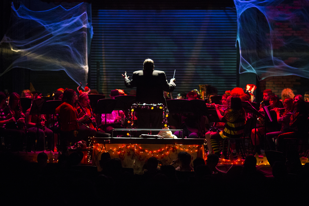 Music teacher Joel Shaner conducts during the Fall Instrumental Concert on Thursday, Oct. 29, 2015, at Jackson High School. Nearly 200 students dressed in Halloween costumes took part in the concert featuring five bands and two percussion ensembles.(Nick Gonzales | Mlive.com)