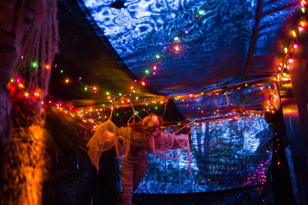 A strung up mummy waits in a dark passage Tuesday, Oct. 27, 2015, at 620 Hibbard St., in Jackson, Mich. Trick-or-treaters will have to go through a spooky passage to retrieve their candy on Halloween. (Nick Gonzales | Mlive.com)