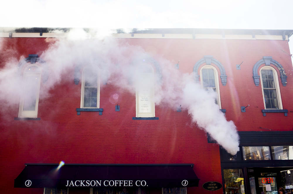Smoke funnels out of Jackson Coffee Company on Friday, Oct. 16, 2015. The Jackson Fire Department arrived on scene. (Nick Gonzales | Mlive.com)