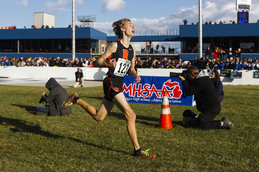Rockford's Isaac Harding leads in the final steps of the Division 1 boys MHSAA state cross country championships at Michigan International Speedway on Saturday, Nov. 7, 2015. (Nick Gonzales | MLive.com)