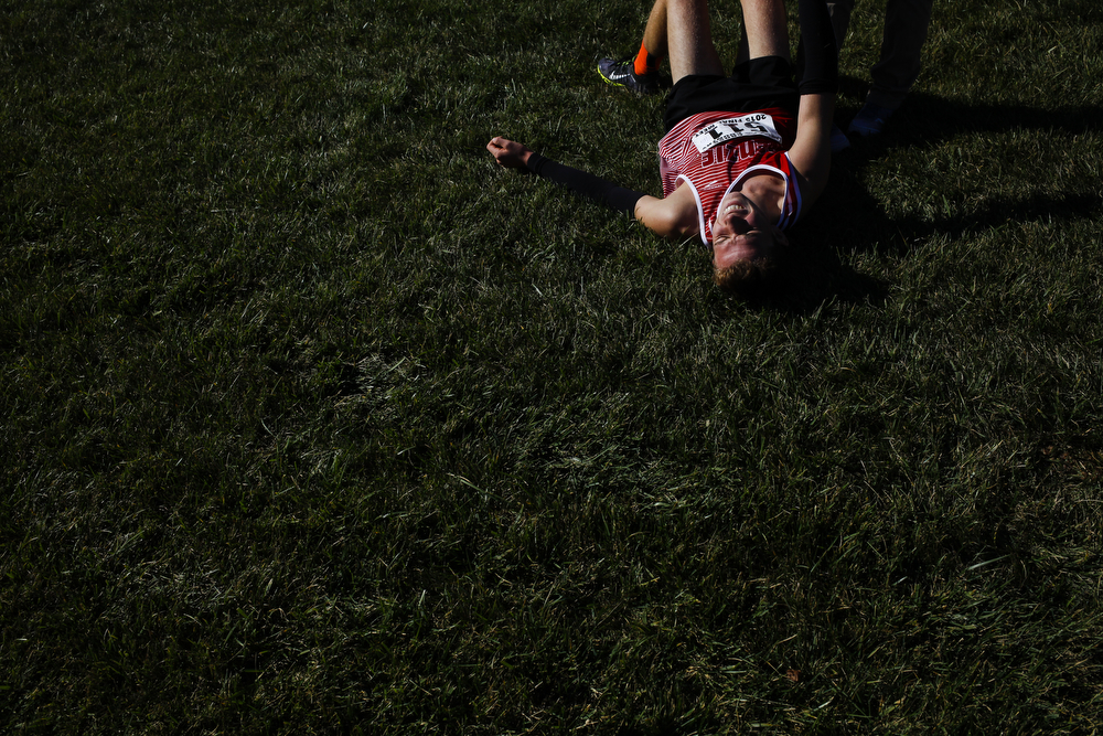 A runner collapses after crossing the finish line in the Division 3 boys MHSAA state cross country championships at Michigan International Speedway on Saturday, Nov. 7, 2015. (Nick Gonzales | MLive.com)