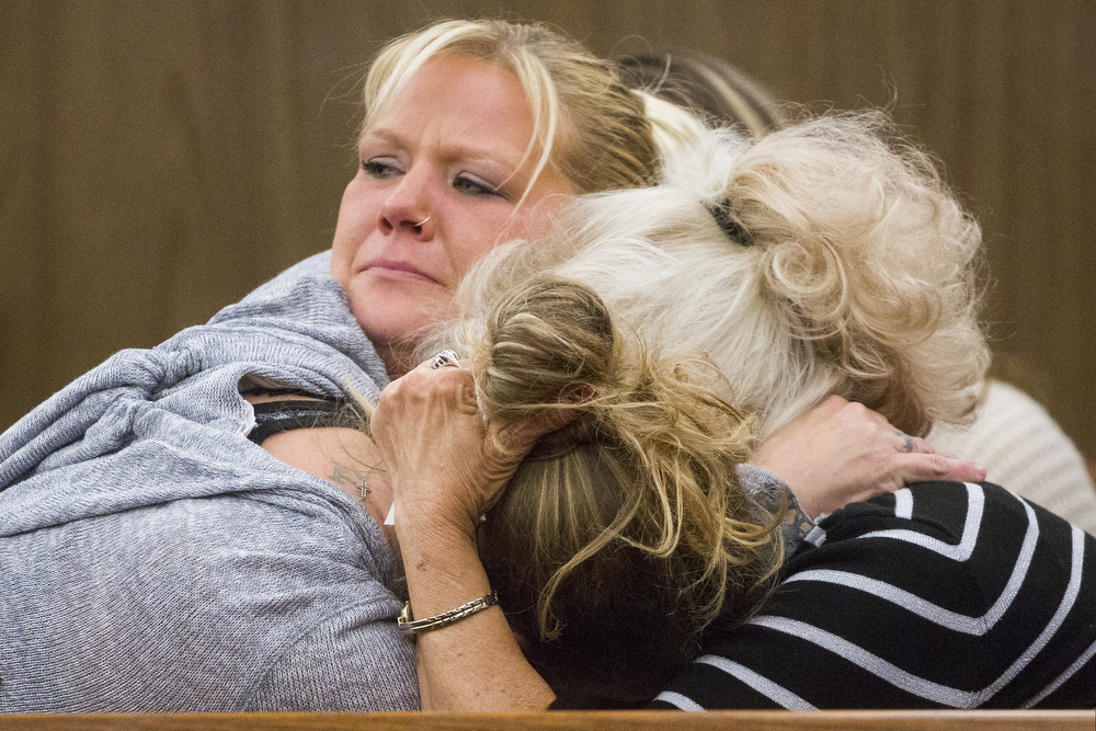 Carrie Circoloff, top, hugs her mother Patti Circoloff, right, and friend Tracie Jo Sutliff in Circuit Court Judge Susan Beebe's courtroom during Jammie Overton's sentencing Wednesday, Nov. 18, 2015, at the Jackson County Courthouse in Jackson. Overton was sentenced to 2 to 7.5 years for failure to stop at the scene of a serious personal injury accident. Carrie's sister and Patti's daughter Michelle Circoloff died in the crash on April 9, 2014. (Nick Gonzales | Mlive.com)