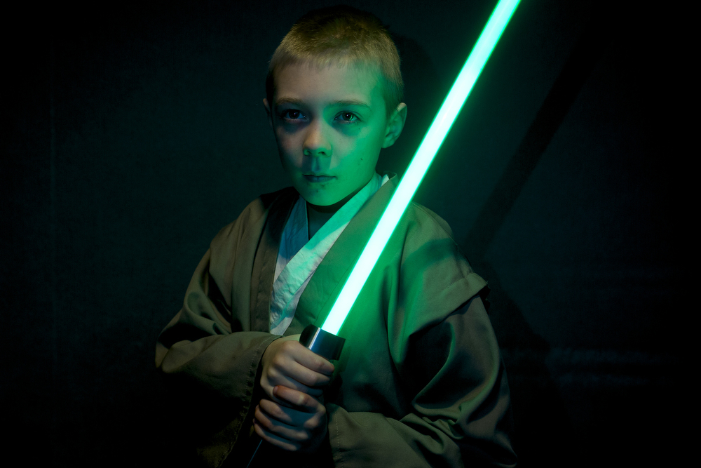 Logan Wolff, 8, dressed as a padawan for the premiere of Star Wars: The Force Awakens on Thursday, Dec. 17, 2015, at the Goodrich Jackson 10 theater in Jackson, Mich. (Nick Gonzales | Mlive.com)