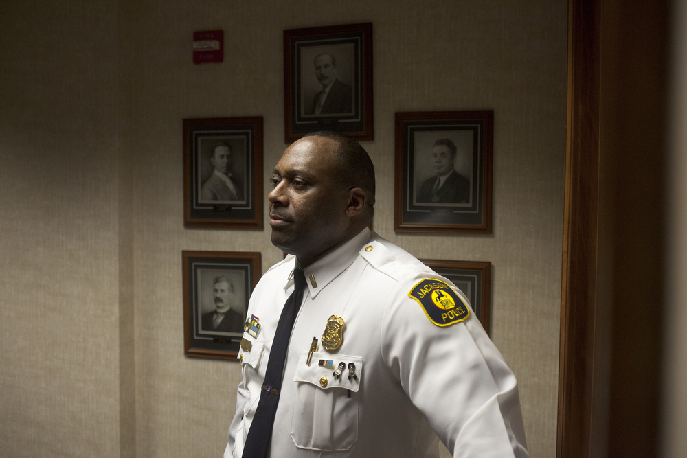 Jackson Police Lt. Christopher Simpson watches a ceremony swearing in new Jackson Police officers Wednesday, Dec. 16, 2015, at City Hall in Jackson, Mich. Three new police officers were sworn in: Andrew Fugate, Patrick Rose and Adam Brooker. (Nick Gonzales | Mlive.com)