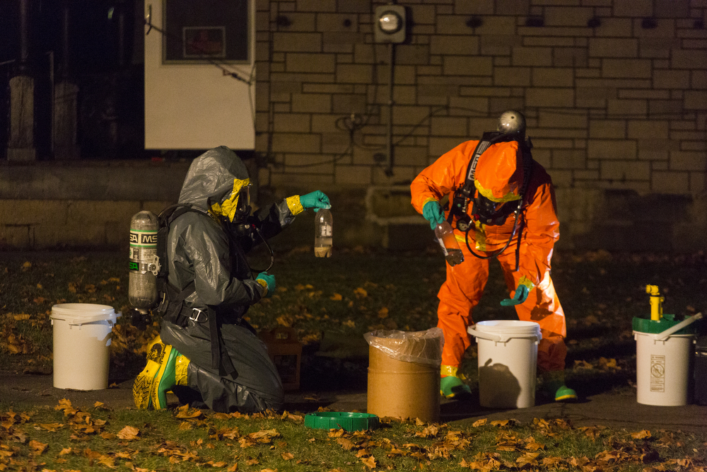 Jackson Narcotics Enforcement Team works the scene of an active meth lab Thursday, Dec. 3, 2015, on the 400 block of Cooper Street in Jackson, Mich. (Nick Gonzales | Mlive.com)