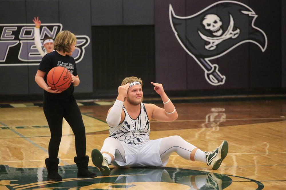 Napoleon senior Britt Swaenepoel celebrates after making a half-court shot during a halftime activities at a boys basketball game Tuesday, Dec. 8, 2015, at Napoleon High School in Napoleon, Mich. Onsted beat Napoleon 61-35. (Nick Gonzales | Mlive.com)