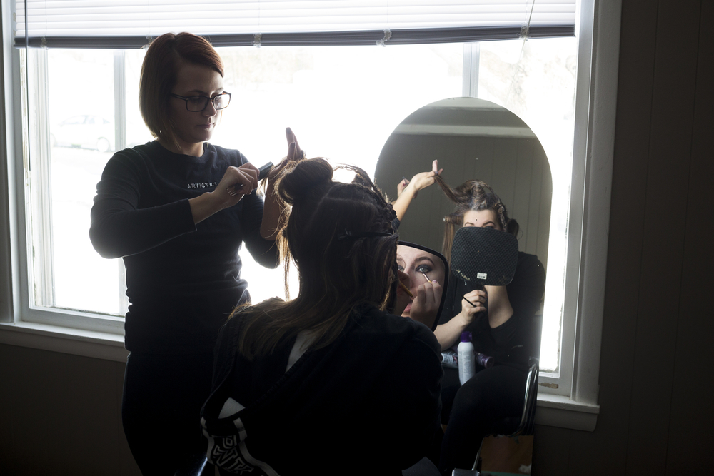 """Amber Moon works on Cara Koning's hair in preparation for Aveda's """"Nature Unleashed presents: Catwalk for Water"""" on Sunday, March 6, 2016, at JW Marriot in Grand Rapids, Mich. Stylists and makeup artists from around Michigan competed in three categories: avant-garde, glamour and makeup. The runway show supported Aveda's Earth Month celebration and the Alliance for the Great Lakes. (Nick Gonzales 