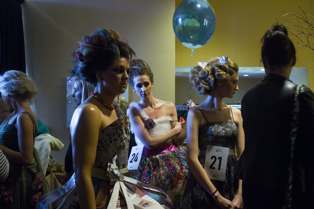 "Models peer into another room where the catwalk is during  a walk through at Aveda's ""Nature Unleashed presents: Catwalk for Water"" on Sunday, March 6, 2016, at JW Marriot in Grand Rapids, Mich. Stylists and make-up artists from around Michigan competed in three categories: avant-garde, glamour and makeup. Fundraised money was donated to Earth Month and The Alliance for the Great Lakes. (Nick Gonzales 