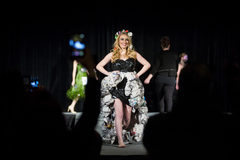 """A model shows off Autumn Harris' glamour outfit during Aveda's """"Nature Unleashed presents: Catwalk for Water"""" on Sunday, March 6, 2016, at JW Marriot in Grand Rapids, Mich. Stylists and makeup artists from around Michigan competed in three categories: avant-garde, glamour and makeup. The runway show supported Aveda's Earth Month celebration and the Alliance for the Great Lakes. (Nick Gonzales 