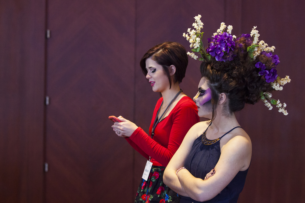 """Designer Sophie Burnett, left, and model Claire Shea at Aveda's """"Nature Unleashed presents: Catwalk for Water"""" on Sunday, March 6, 2016, at JW Marriot in Grand Rapids, Mich. Stylists and makeup artists from around Michigan competed in three categories: avant-garde, glamour and makeup. The runway show supported Aveda's Earth Month celebration and the Alliance for the Great Lakes. (Nick Gonzales 