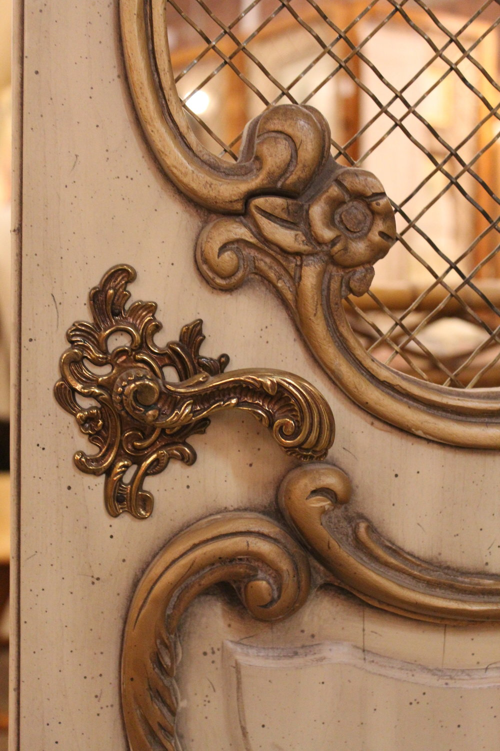 Gold handle and detail on antique armoire