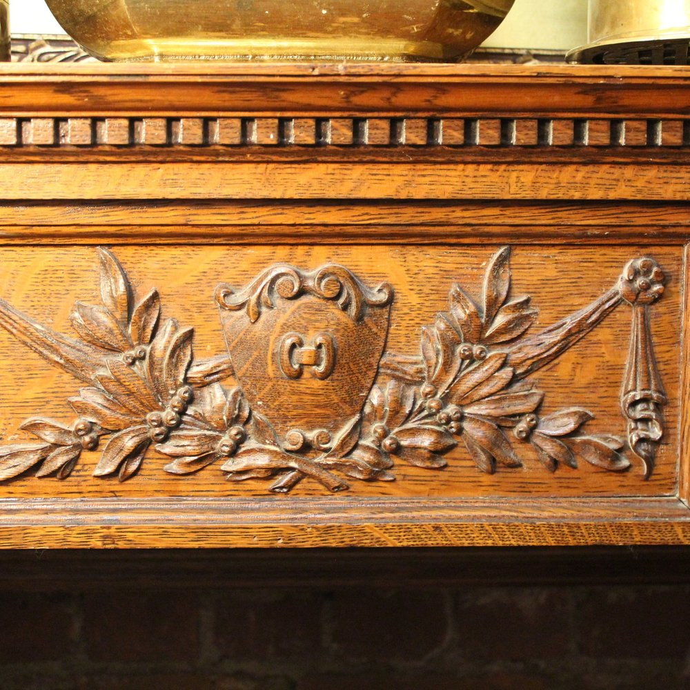Carved detail on antique wood mantle