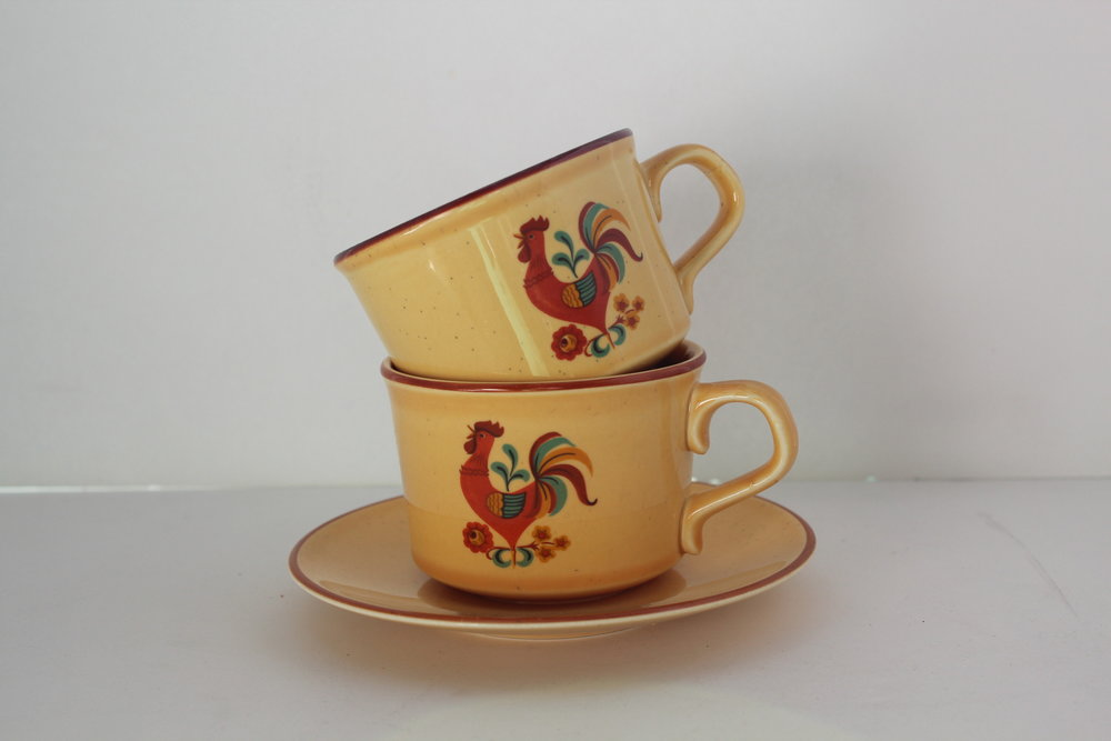 Yellow rooster teacup and saucer set
