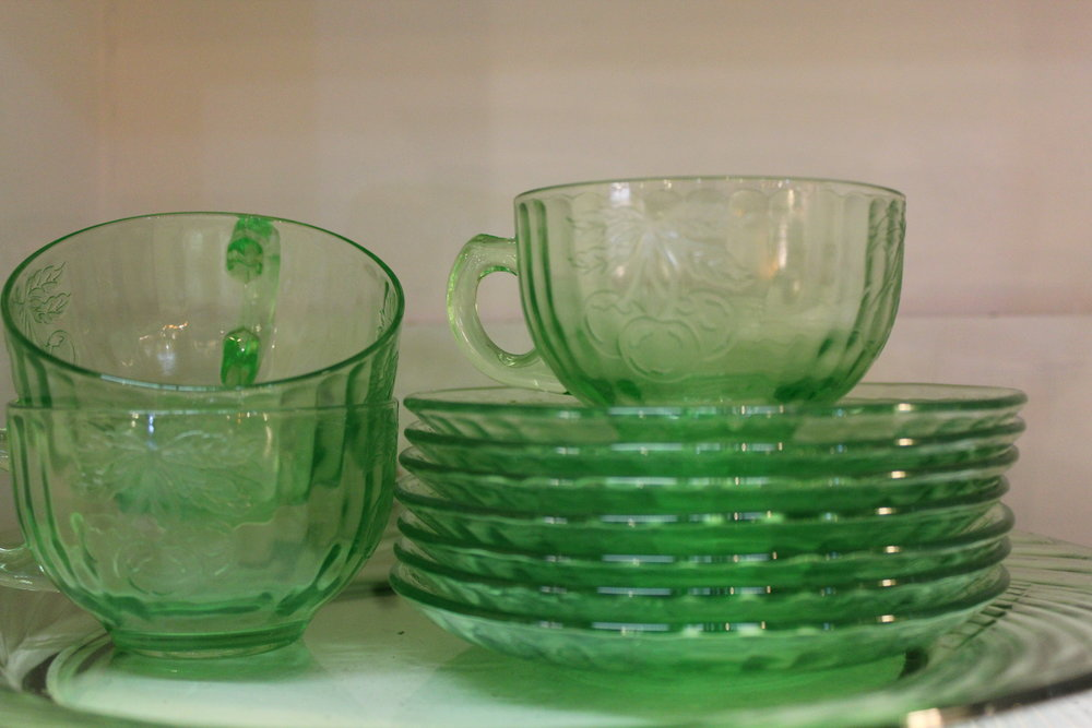 Green depression glass plates and cups
