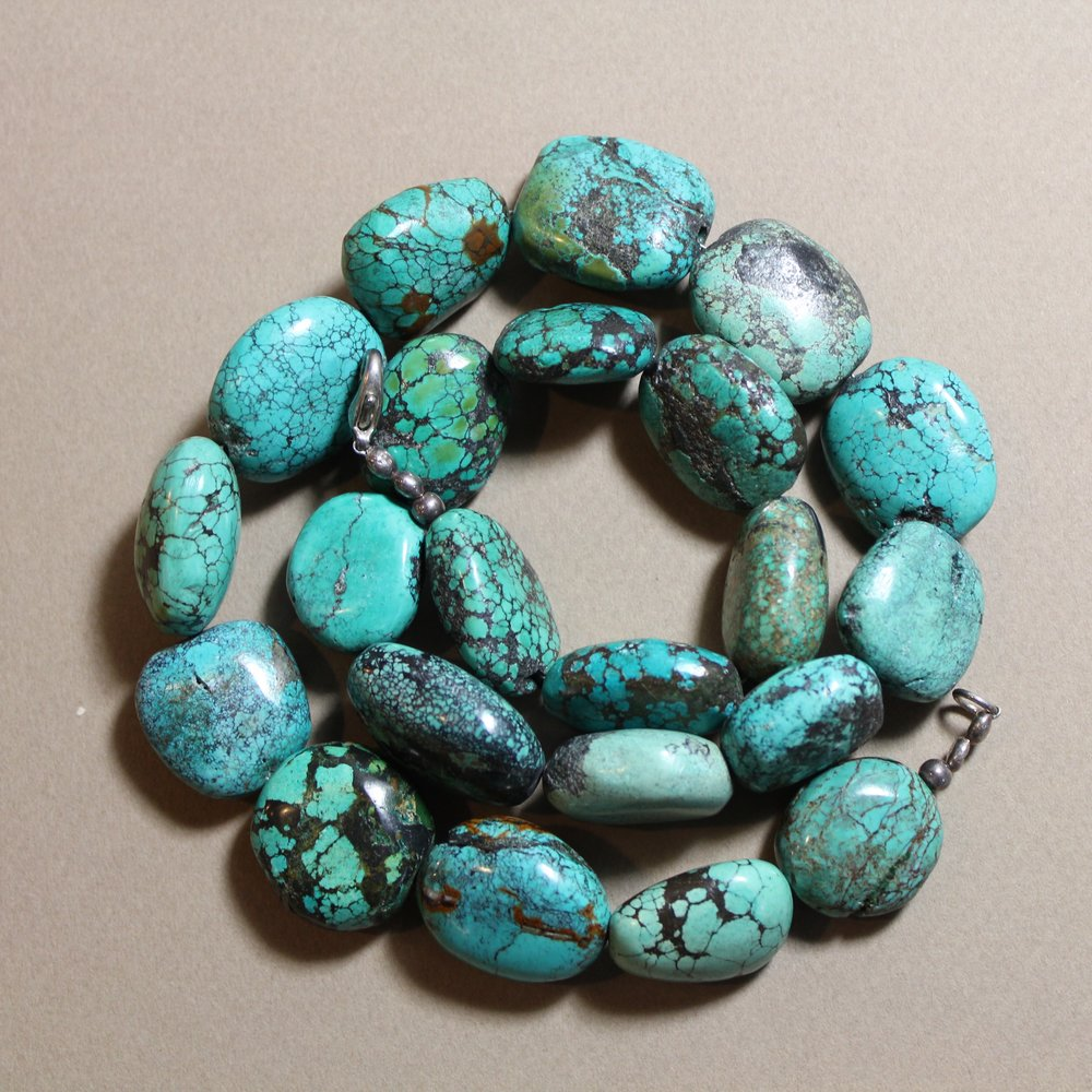blue stone necklace coil.jpg