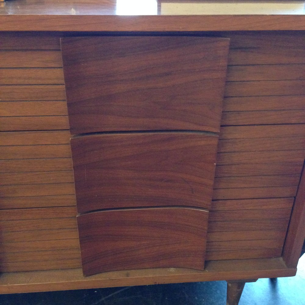cose up of midcentury modern wood bureau