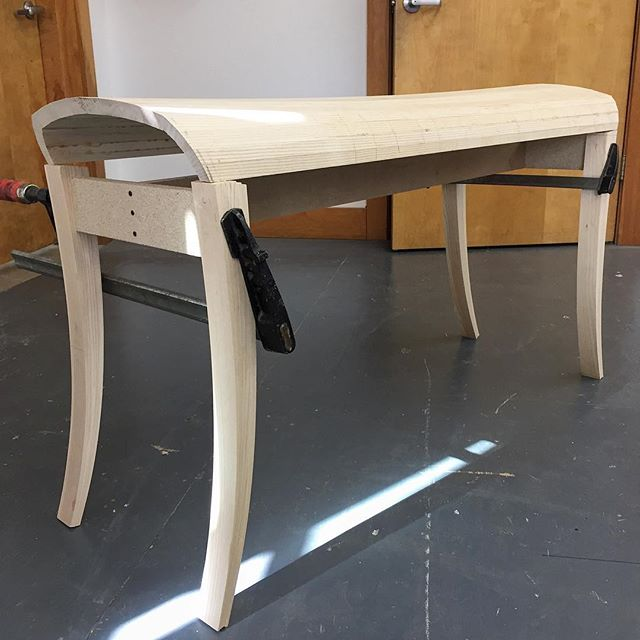 A bench that I'm in the process of finishing up. Steam bent and coopered top. Tapered bent laminated legs. Currently with a sexy particle board stretcher. Made from one big slab of ash. #ash #woodwork #coopered #cooperage #bentlamination #bench #design #wooddesign #quartersawn