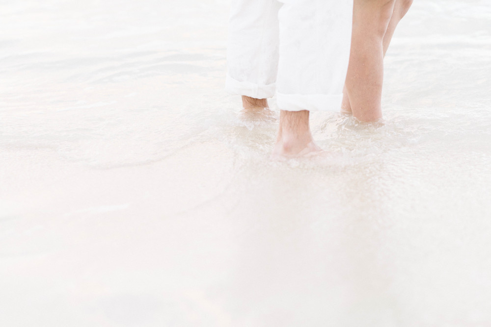 Feet in Surf by Melissa Wessel, Destination Elopement Photographer