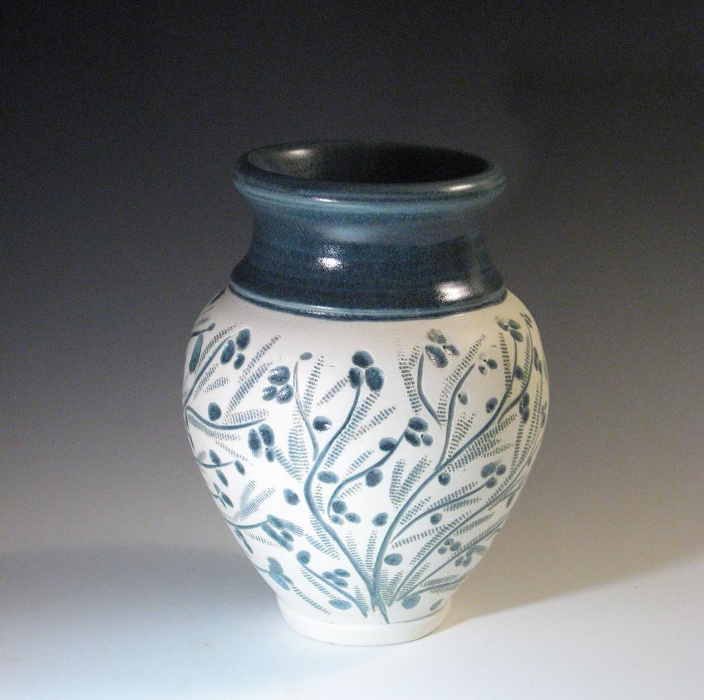 Blue  flowers on  white vase