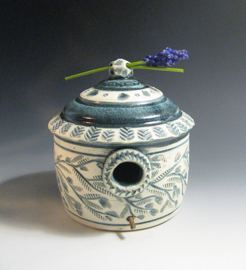 Variegated blue bird house