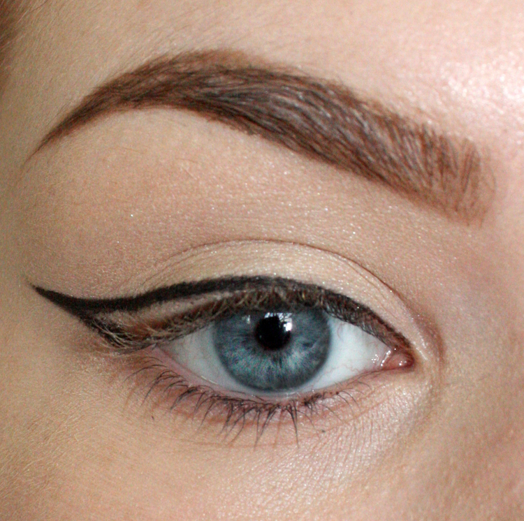 Starting at the inner corner, apply your liner as close to the lashline as  possible, meeting up with your second mark.