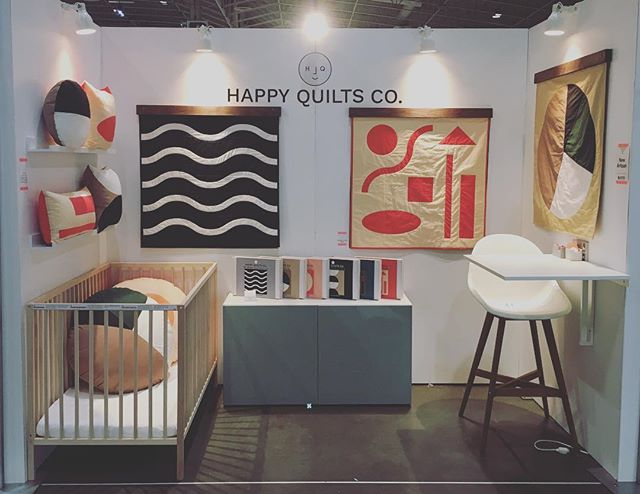 Early morning helping our good friend @happyquiltsco set up her booth at #ooaks18 2018.  We also made these walnut quilt hangers to show off these beauties!