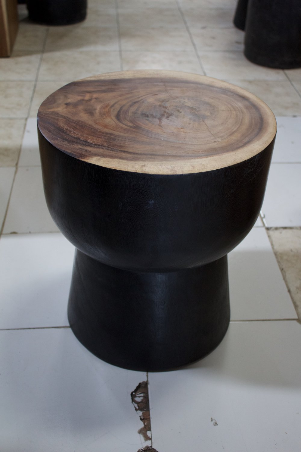 "Bali Mushroom Side Table   15.7""D x 16.9""H   Price: $280"