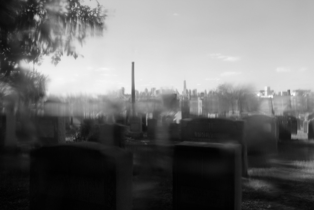 Image captured at the Calgary Cemetery in Queens, NY 2013 while looking through a plastic drinking bottle filter.